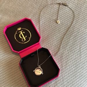 Juicy Couture Love/Hate spinning pendant necklace
